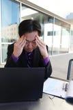 Hombre de negocios asiático tensionado Fotos de archivo