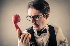 Hombre de negocios asqueado en el teléfono Fotos de archivo