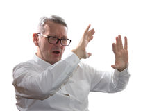Hombre de negocios asustado aislado en blanco Fotografía de archivo
