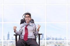 Hombre de negocios atado en cuerda en la oficina Fotos de archivo libres de regalías