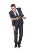 Hombre de negocios atado para arriba en cuerda Fotos de archivo libres de regalías