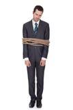 Hombre de negocios atado para arriba en cuerda Imagen de archivo libre de regalías