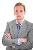 Hombre de negocios atractivo en su 20s en gris Foto de archivo libre de regalías