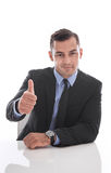Hombre de negocios atractivo que hace frente a la cámara: pulgar para arriba aislado en whi Imagen de archivo libre de regalías