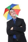Hombre de negocios bajo el paraguas Imagen de archivo libre de regalías