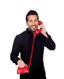 Hombre de negocios barbudo joven en el teléfono Fotografía de archivo libre de regalías