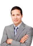 Hombre de negocios carismático con los brazos plegables Fotos de archivo libres de regalías