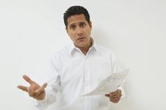 Hombre de negocios chocado With Documents Foto de archivo