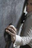 Hombre de negocios Climbing Wall fotografía de archivo libre de regalías