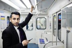 Hombre de negocios Commuting en metro Fotos de archivo libres de regalías