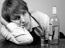 Hombre de negocios con alcohol Foto de archivo libre de regalías