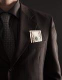 Hombre de negocios con cientos dólares Fotografía de archivo