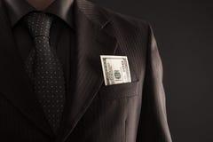 Hombre de negocios con cientos dólares Fotos de archivo