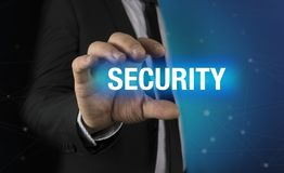 Hombre de negocios con concepto de la seguridad en sus manos Imagenes de archivo