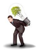 Hombre de negocios con del eco de la lámpara la parte posterior encendido Imagen de archivo libre de regalías