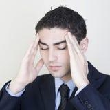 Hombre de negocios con dolor de cabeza fotos de archivo libres de regalías
