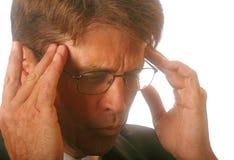Hombre de negocios con dolor de cabeza Foto de archivo libre de regalías