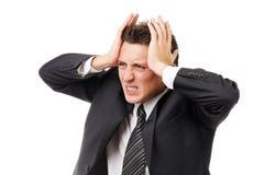 Hombre de negocios con dolor de cabeza severo imagenes de archivo