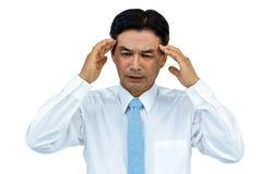 Hombre de negocios con dolor de cabeza severo imágenes de archivo libres de regalías