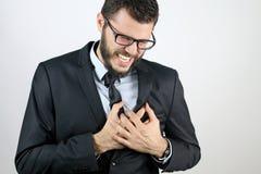 Hombre de negocios con dolor de pecho Foto de archivo libre de regalías