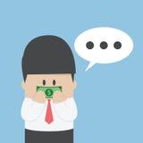 Hombre de negocios con el billete de dólar grabado en su boca Foto de archivo libre de regalías