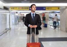 Hombre de negocios con el bolso de la carretilla Fotos de archivo libres de regalías