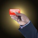 Hombre de negocios con el botón off-line Imagen de archivo libre de regalías