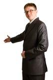 Hombre de negocios con el brazo hacia fuera en un gesto que da la bienvenida Imagenes de archivo