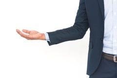 Hombre de negocios con el brazo hacia fuera en un gesto que da la bienvenida Imágenes de archivo libres de regalías