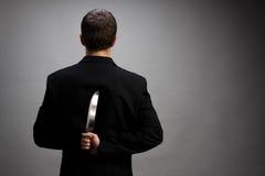 Hombre de negocios con el cuchillo Imagenes de archivo