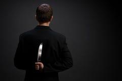 Hombre de negocios con el cuchillo Fotografía de archivo