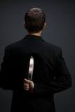 Hombre de negocios con el cuchillo Foto de archivo libre de regalías