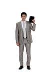 Hombre de negocios con el diario Fotografía de archivo
