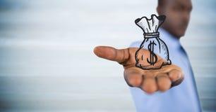 Hombre de negocios con el gráfico del bolso del dinero en mano extendida contra el panel de madera azul borroso imagenes de archivo