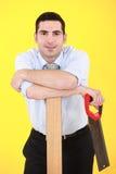 Hombre de negocios con el hand-saw Imagen de archivo libre de regalías