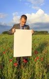 Hombre de negocios con el letrero Fotografía de archivo