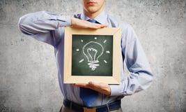 Hombre de negocios con el marco Imagen de archivo libre de regalías