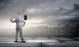 Hombre de negocios con el martillo Imagenes de archivo