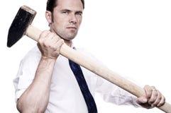 Hombre de negocios con el martillo de trineo Fotos de archivo libres de regalías