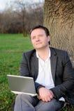 Hombre de negocios con el ordenador portátil Imágenes de archivo libres de regalías