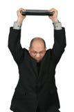 Hombre de negocios con el ordenador sobre su cabeza Imágenes de archivo libres de regalías