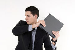 Hombre de negocios con el ordenador superior de regazo Imágenes de archivo libres de regalías