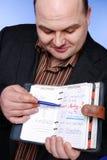 Hombre de negocios con el organizador foto de archivo