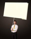 Hombre de negocios con el papel del post-it Imágenes de archivo libres de regalías