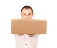 Hombre de negocios con el paquete Imagen de archivo libre de regalías