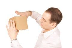 Hombre de negocios con el paquete Fotos de archivo libres de regalías