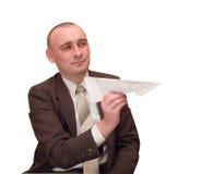 Hombre de negocios con el plano de papel. Fotografía de archivo libre de regalías