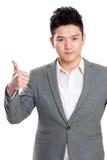 Hombre de negocios con el pulgar para arriba Imagen de archivo