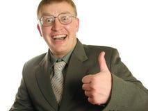 Hombre de negocios con el pulgar para arriba en vidrios Fotos de archivo libres de regalías