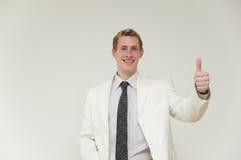 Hombre de negocios con el pulgar para arriba encendido Imagen de archivo